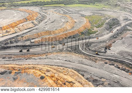 Large Quarry Dump Truck. Big Yellow Mining Truck At Work Site. Loading Coal Into Body Truck. Product