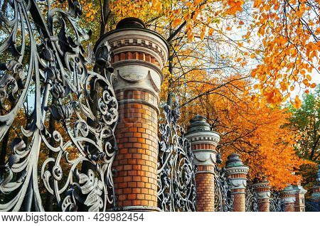 Autumn in St Petersburg, fence of the Mikhailovsky Garden in St Petersburg, Russia in autumn day. Autumn architecture view of St Petersburg landmark