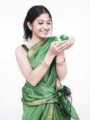 beautiful young asian woman of indian origin with a green coloured chick poster