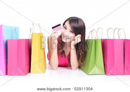 Young Girl Lying With Shopping Bags