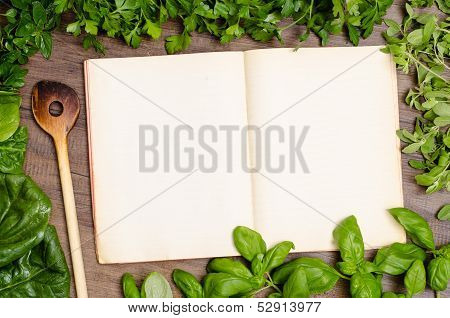 Green Herbs As Frame Around A Cookbook