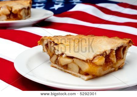Shallow focus horizontal image of 2 pcs of apple pie on the American flag poster