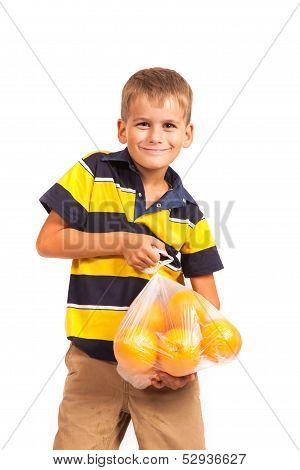 Boy holding oranges isolated on white background poster