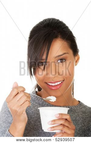 Young beautiful woman eating yogurt as healthy breakfast or snack. Isolated on white