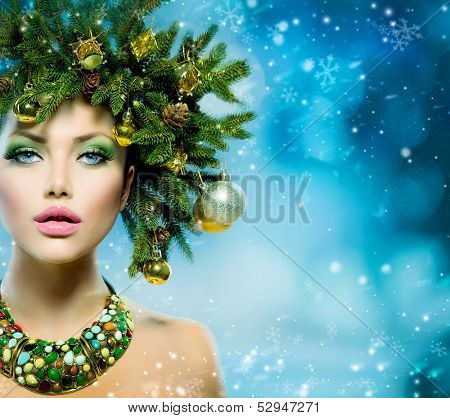 Christmas Winter Woman. Beautiful New Year and Christmas Tree Holiday Hairstyle and Make up. Beauty Fashion Model Girl over Snow Background with Snowflakes. Creative  Hair style decorated with Baubles poster