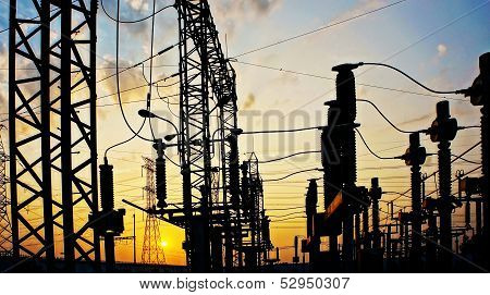 Transformer station with colorful sky at sunrise poster