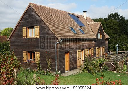 Wooden House With Solar Panels And Shutters
