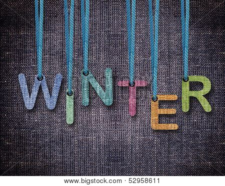 poster of Winter letters hanging strings with blue sackcloth background.