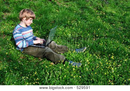 Browser (child With Notebook Sit Green Grass)
