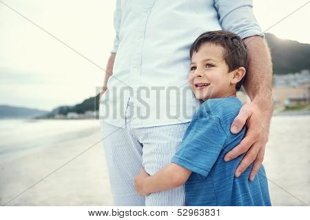 Feeling of safety and security, love hug from father and son at beach
