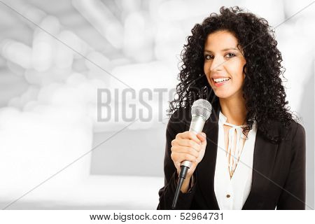 Portrait of a beautiful woman speaking in a microphone poster