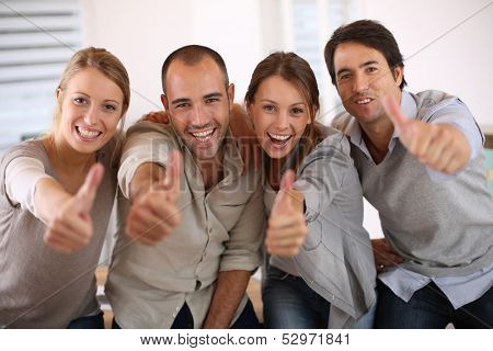 Business team shwoing thumbs up