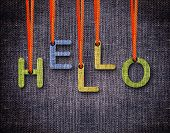 Hello Letters hanging strings with blue sackcloth background. poster