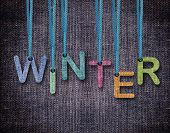 Winter letters hanging strings with blue sackcloth background. poster