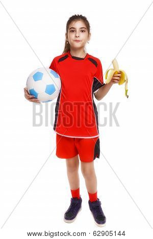 Young Soccer Player Eating Banana As Halftime Snack