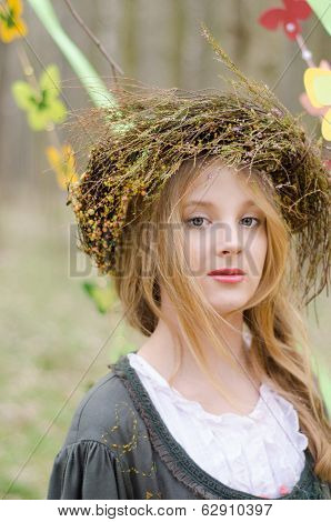 Close Up Portrait Of A Pretty Pensive Girl In A Folk   Circlet Of Flowers