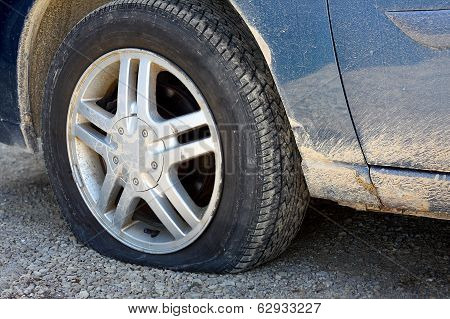 Flat Tire On Old Dirty Car