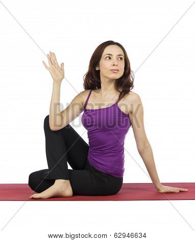 Young Woman Doing Half Lord Of The Fishes Pose In Yoga