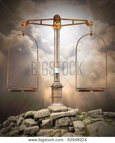 Weight scale on the peak against heaven. Divine justice concept.