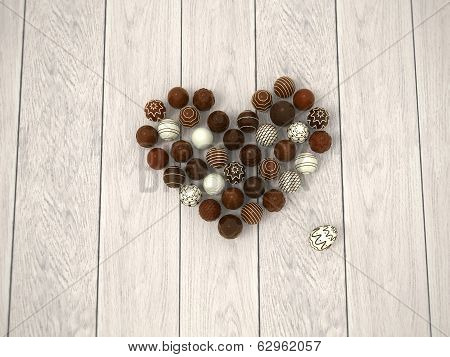 Chocolate Easter Eggs Heart On White Wooden Floor - Top View
