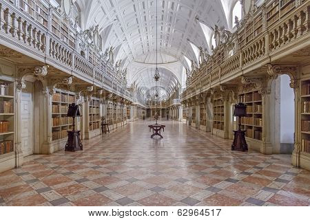 Mafra, Portugal - September 02, 2013: Library of the Mafra National Palace. Franciscan religious order. 18th Century Baroque architecture.