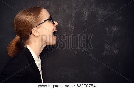 Concept Woman In Glasses Said At A Blank Blackboard
