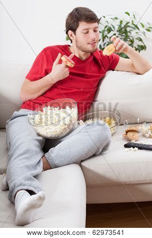 Couch Potato Eating Junk Food