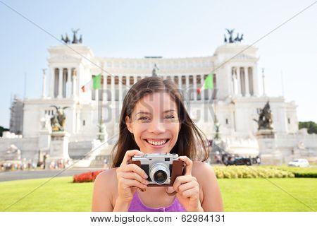 Rome tourist taking photo picture on retro camera. Woman on travel in Italy in front of Altare della Patria, Monumento Nazionale a Vittorio Emanuele II also called il Vittoriano. Rome, Italy tourism. poster