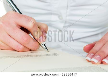 a woman signs a contract or a will with a fountain pen. poster