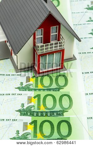 residential house on banknotes, symbolic photo for home purchase, financing, building society