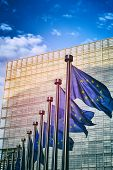 EU flags in front of European Commission in Brussels Belgium poster