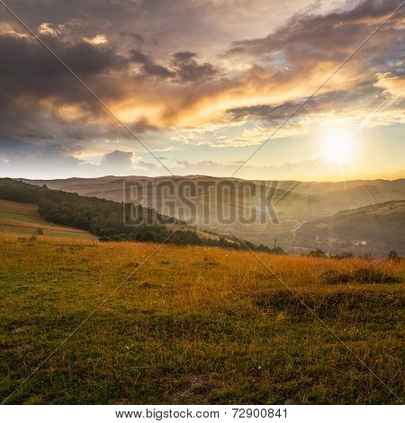 Field In Mountain Near Home At Sunset