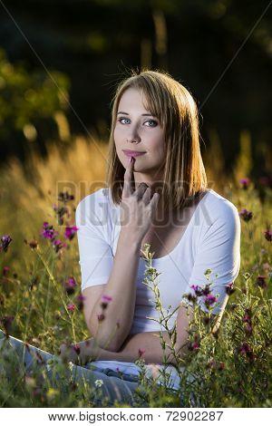 Pensive Woman In Blooming Meadow