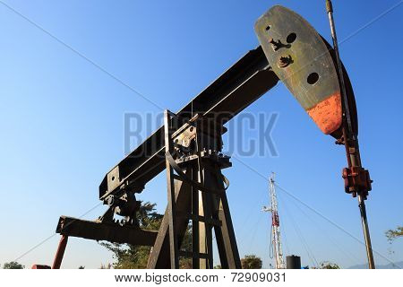 Sucker Rod Beam (Oil Pump Jack) and Drilling Rig poster