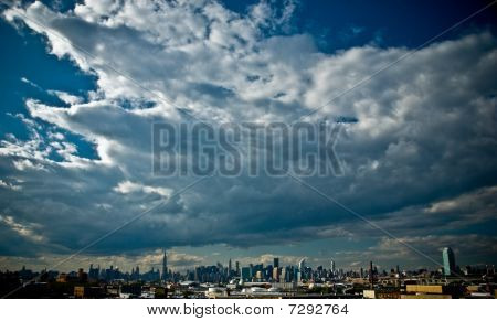 New York City Skyline With Blue Sky and Clouds