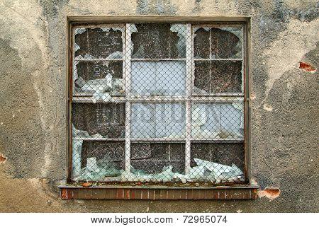 Broken window in an old industrial building