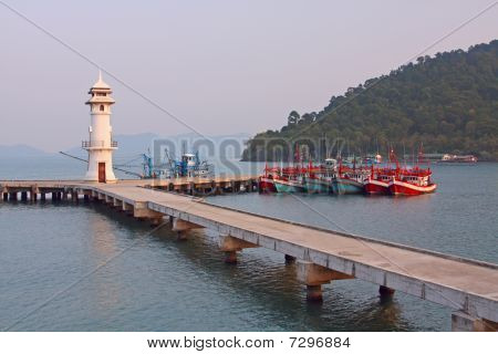 Lighthouse And Boats
