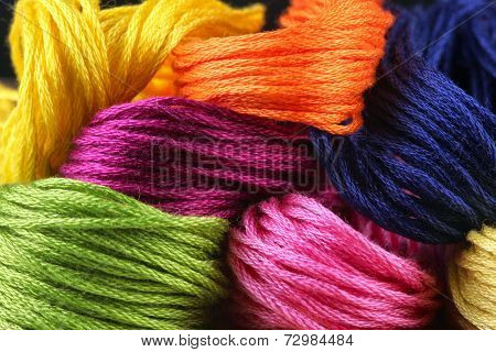 poster of bright iridescent thread floss for embroidery and needlework
