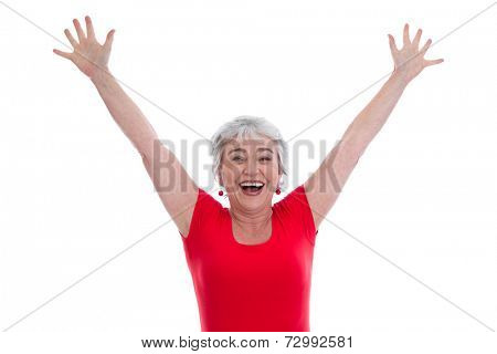 Isolated happy senior woman celebrating victory