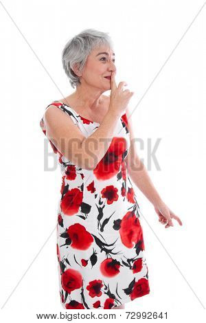 Senior woman making silent sign