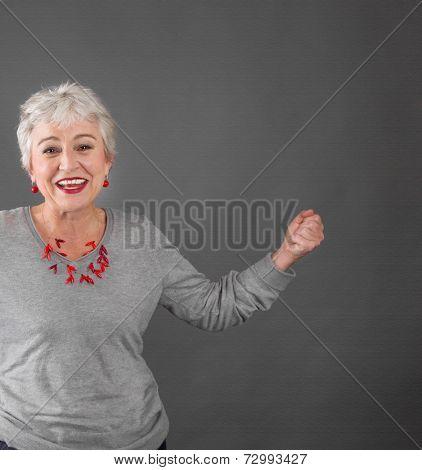 Happy senior woman celebrating success