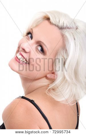 Woman looking over her shoulders wearing spaghetti strap top