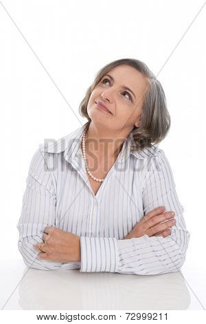 Senior grey haired woman folding arms and fond memories , dreaming isolated on white background