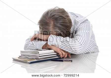 Grey haired woman sleeping on books - overworked isolated on white background