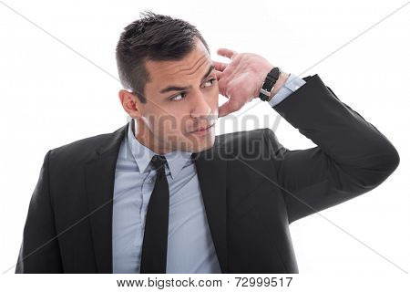 Hearing: attractive young business man listening to isolated on white background - hard of hearing