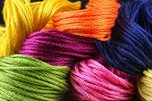 bright iridescent thread floss for embroidery and needlework poster