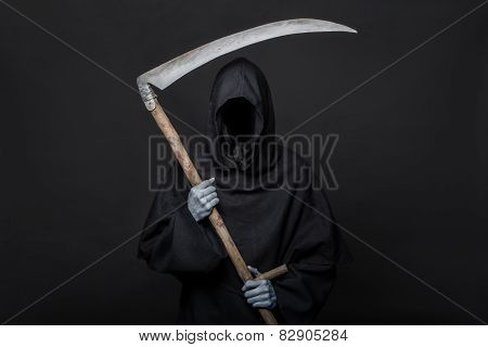 Death reaper over black background. Halloween
