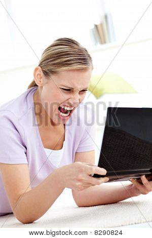 Furious Young Woman Screaming At Her Laptop