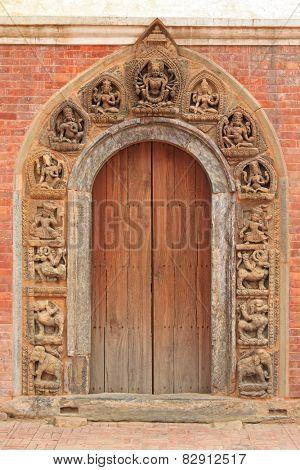 PATAN, NEPAL - APRIL 2014 : Intricate and beautiful doorframe in Patan, Nepal on 13 April 2014.