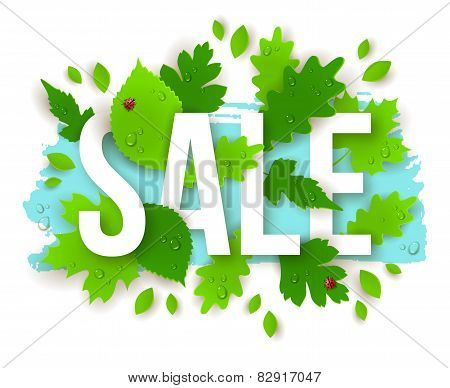 Sale Text with Spring Green Leaves.